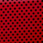 Black spot on red quilting fabric