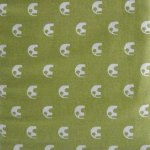 White elephants on green quilting fabric