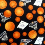 Basketballs on black quilting fabric