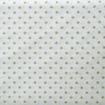 Green small spots on white fabric